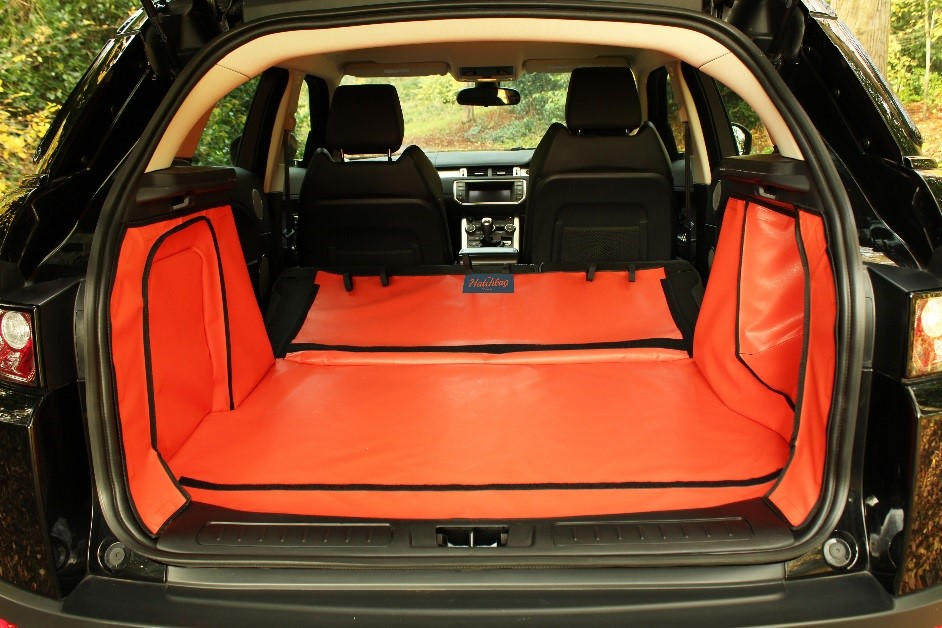 an orange boot liner with folded rear seats