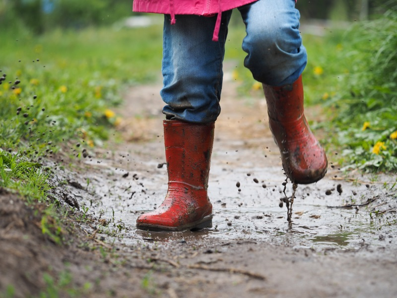 a child walking on a muddy path