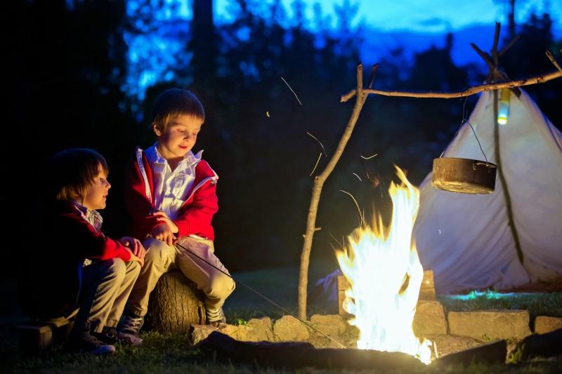 children by a campfire